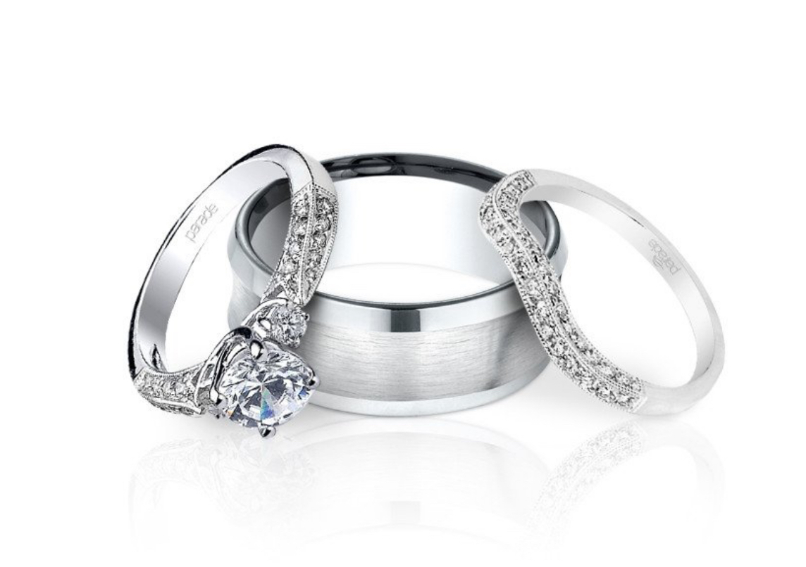 a diamond engagement ring and two wedding bands stacked together