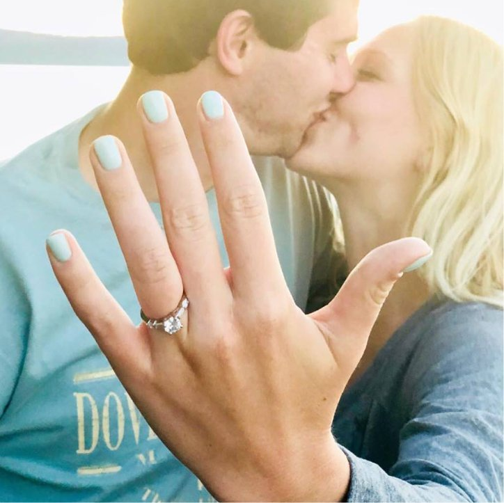Kissing Couple Shows Off Engagement Ring