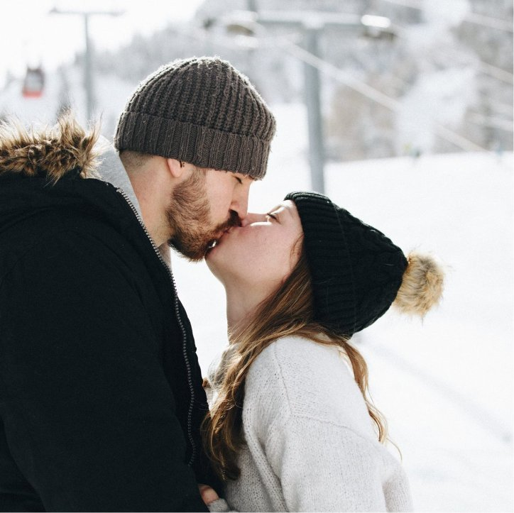 Engaged Couple Kissing in Snow