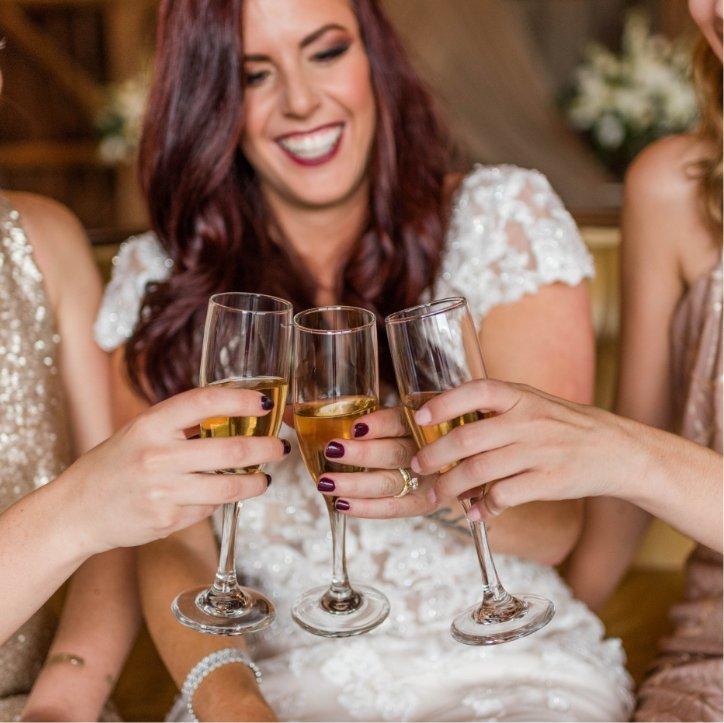 Women Cheers with Glasses to New Engagement