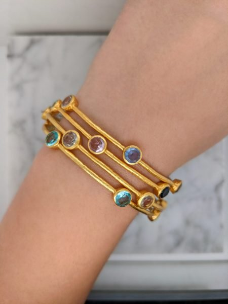 gold bangle bracelets with brightly colored gemstones