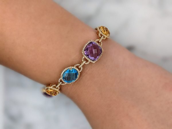 a diamond link bracelet with brightly colored gemstones