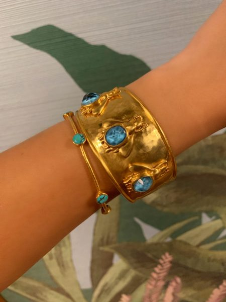 gold turquoise bangle layered with gold pacific blue bee cuff